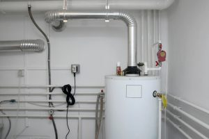 tank water heater with pipes running in and out