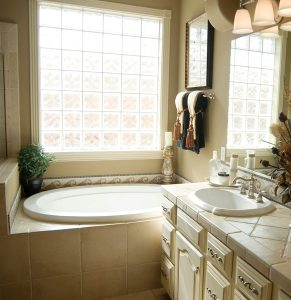 bathtub and sink in large bathroom
