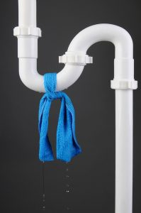 plumbing pipe with blue cloth tied around leak