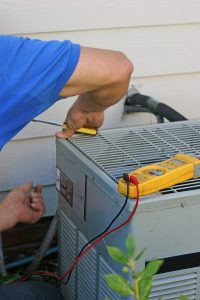 technician working on air conditioning system