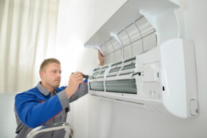 technician-fixing-heat-pump